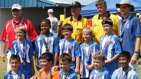 Boy plays with 'heavy heart' in AYSO Games