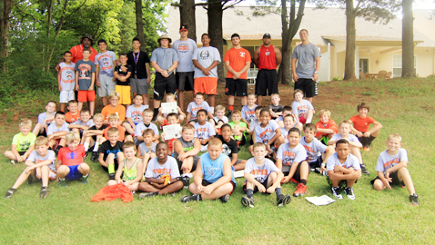 Campers and volunteer instructors pose for the camp photo at Levi Park Saturday, July 12.  Photo by Tracy Heard.