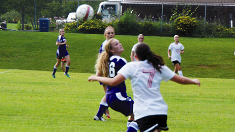 Photo by Dan Andrews. Halls High School sophomore soccer player Taylor Grabner (7) battles for the ball with Sevier County's Megan Price in the season opener for both schools. The Lady Devils prevailed 2-1 in Tuesday's match.