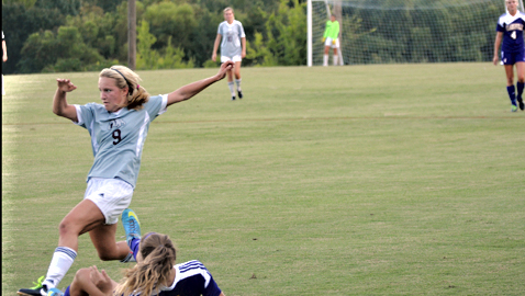 Bearden's Clarity Voy (9) tangles with Clarksville's Gybson Roth in Thursday night's opener of the Bearden Invitational. The Lady Bulldogs and Lady Wildcats played to a 3-3 tie at Bruce Allender Field.