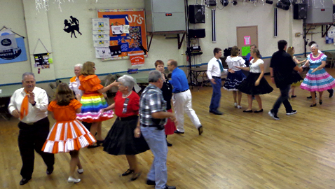 """The Grand Square Club also includes eight Carter High School students and most club members dress in the """"Western"""" style clothing."""