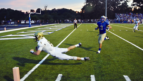 By Dan Andrews. Catholic quarterback Zac Jancek avoids CAK defender Wyatt Eaton and plunges into the end zone. Jancek rushed for 95 yards and accounted for five touchdowns in the Irish's 70-23 win over the Warriors in the District 4-AA opener for both teams.