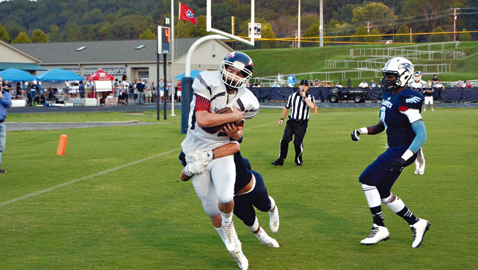Photo by Dan Andrews, South-Doyle's Dylan Cameron (in white) hauls in a 16 yard touchdown pass from Brody Rollins to give the Cherokees an early 7-0 lead against Hardin Valley on Friday night.  The 10th ranked Cherokees improved to 3-0 on the year with a 47-21 road win over the Hawks.