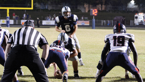 Photo by Dan Andrews. Farragut quarterback Jacob Naumoff prepares to take a snap against West Friday night. Naumoff threw for 324 yards in  his best outing of the season. It wasn't enough as the Admirals lost a shootout to the Rebels 49-30.