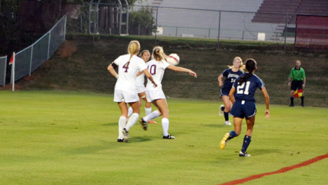 Farragut's Jordan Fierley (7) blocks a shot from Bearden's Emily Mayfield in the Lady Admirals 2-1 District 4-AAA victory over the Lady Bulldogs Thursday night at Bruce Allender Field. The win was Farragut's fifth straight over Bearden since 2011. Photo by Dan Andrews.