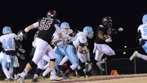 PHOTO BY COURTNEY RADER Fulton's D.J. Campbell is on the loose in the Falcons' 49-14 win over Sullivan South in Class 4A quarterfinal action Friday night at Bob Black Field. Tackle Tripp Carver (56) gets down field to help block for Campbell.