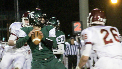 PHOTO BY CATHY DOWHOS-O'GORMAN Webb quarterback Brock Beeler hangs in the pocket, with ECS end Christian Rosenberger (26) closing in, to make a pass during the Spartans' 21-7 win over the Eagles in Friday night semifinal action at Faust Field.