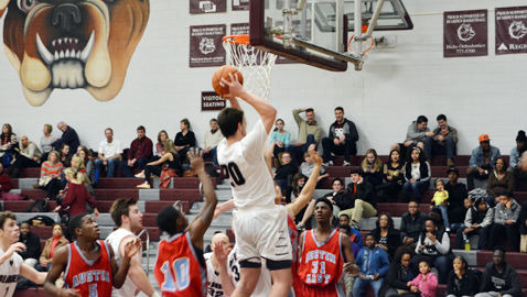 Bearden's Austin Duncan (20) shoots a layup while Austin-East defender Lucky Clark looks on. Duncan scored 18 points for the Bulldogs in a 92-63 win over the Roadrunners Thursday night. With the win, Bearden kept its perfect record intact.