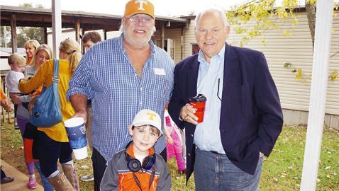 """Dave Moore (left) and Phillip Fulmer, along with Moore's grandson, J.B. Moore, share time together this past fall. It was """"dress up who you would like to be like"""" day at Rocky Hill Elementary school, where 5-year-old J.B. is in kindergarten. Notice the head phones J.B. is wearing. He was dressed like his grandfather, a former coach."""