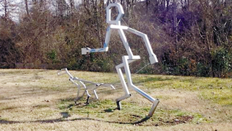 Photo by Mike Steely. Along the Third Creek Greenway you might chance across this sculpture. The greenway sees lots of dog walkings, bikers, runners, and people enjoying a strip of nature in the city.