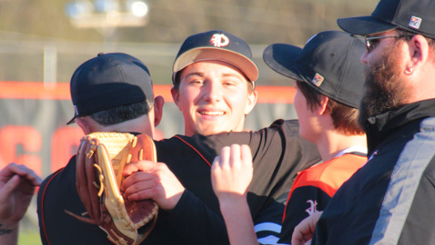 PHOTO BY KRISTY TETER OF KT PHOTOGRAPHY Peyton Alford gets a hug from Powell High head coach Jay Scarbro as the Panthers celebrate the junior southpaw's perfect game in a 3-0 win at Clinton last week.