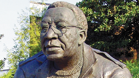 The statue of Alex Haley sits looking out over Morningside Park, taken before someone stole his glasses.