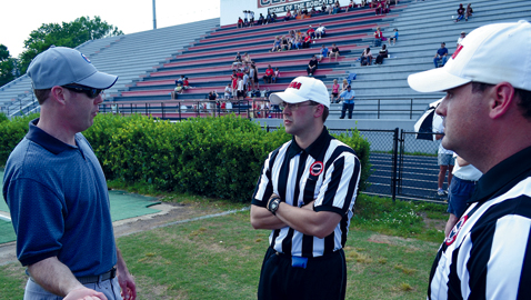 Lee Hedrick (left) instructs officials at the East Tennessee clinic in May at Central High  School. Hedrick will be a new full-time official in the Southeastern Conference this fall.  Hedrick will be a Center Judge, a new position in SEC crews this season.