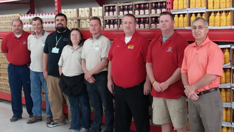 Photo by Mike Steely United Grocery Outlet CEO Michael Tullock (right) and Chapman manager Matt Storm are pictured with the new store's staff. The UGO company is the largest close-out grocery company in the Eastern United States.