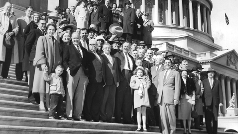 "Photo from the author's personal collection. Congressman Robert A. ""Fats"" Everett celebrates his election to Congress on the steps of the Capitol with friends and family.  Everett is in the center, waving his hat."