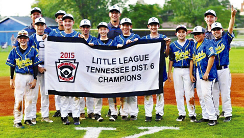 Karns displays the District 6 Little League championship banner after posting a 13-3 win over Maryville Thursday night. Players (left to right): Harrison Garrett, Jackson Campbell, Matthew White, Matthew Bringle, Ty Vineyard, Tyler Nicely, Payton Adkisson, Jacob Parker, Ben Smith, Johnny Eller and Jordin Vinson. Coaches (left to right): Mike Vineyard, Rob Eller and Taco Bell.