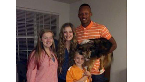 """Lizzie, Ali and Caroline (left to right) """"fell in love"""" with UT quarterback Joshua Dobbs when he visited the home of David Fisher, his mentor during his internship in May. Dobbs also was fond of the Fishers' dog, a Sheltie named Titan."""