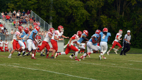 PHOTO BY DAN ANDREWS Austin-East scoops and scores a defensive touchdown on this play to take the lead against Halls Friday night at A-E. The Roadrunners won, 46-22.