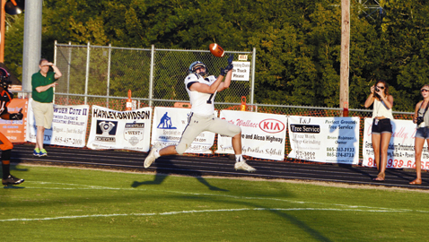 Photo by Dan Andrews. Farragut's Cole Morgan pulls in a touchdown pass in the Admirals' 49-6 win over Powell Friday at Scarbro Stadium. Morgan's scoring reception culminated an 8-play, 88- yard drive and was the first score of the game.
