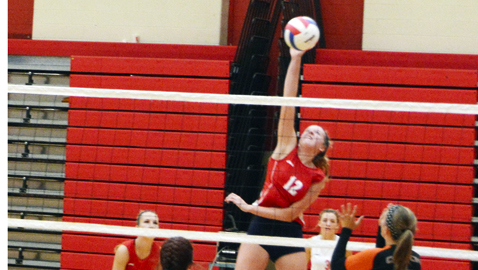 Halls High middle blocker Micah DePetro makes the winning spike in the Lady  Devils four-set victory over Clinton Tuesday night at Halls.