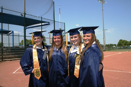 Four Seymour seniors feel right at home on graduation day