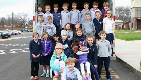 Episcopal First Graders Take Truckloads to Holiday Bureau